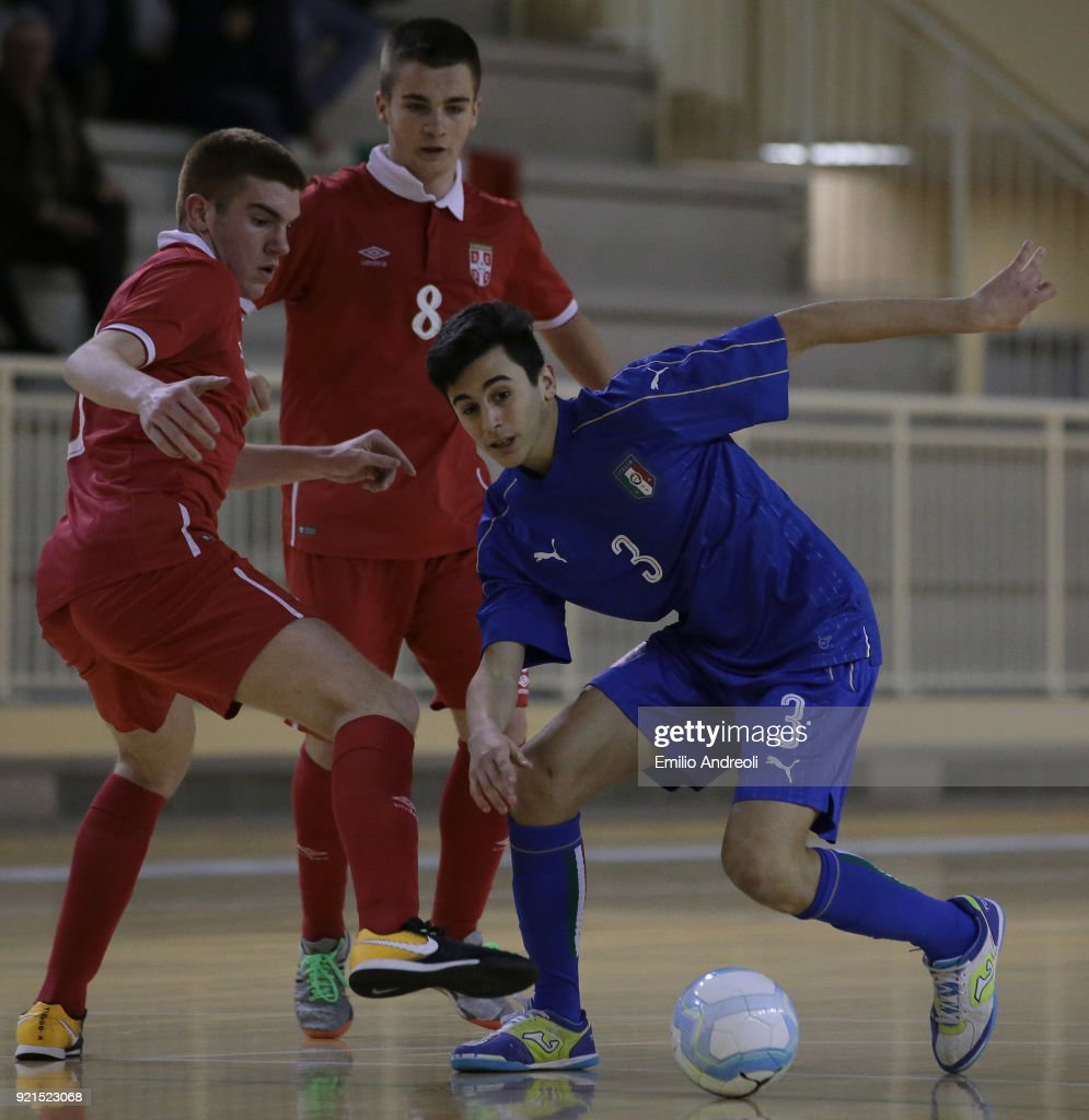 Gianluca Ferretti (R) of Italy is challenged by Lazar Marinkovic of Serbia during the Futsal International Friendly match between Italy U19 and Serbia U19 at Novarello Training Center on February 20, 2018 in Novara, Italy.
