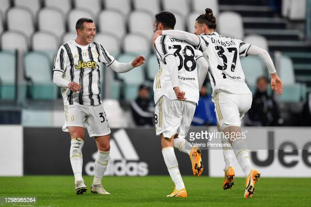 Gianluca Frabotta of Juventus celebrates after scoring their sides second goal with team mate Federico Bernardeschi during the Coppa Italia match...