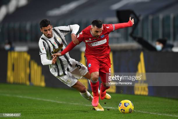 Gianluca Frabotta of Juventus clashes with Alberto Paloschi of SPAL during the Coppa Italia match between Juventus and SPAL at Allianz Stadium on...