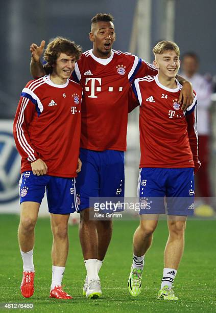 Gianluca Gaudino Jerome Boateng and Sinan Kurt react during day 2 of the Bayern Muenchen training camp at ASPIRE Academy for Sports Excellence on...
