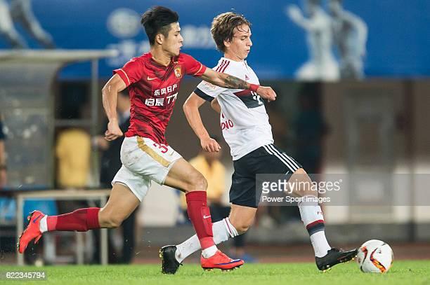 Gianluca Gaudino of Bayern Munich being followed by Mei Fang of Guangzhou Evergrande during the match between Bayern Munich and Guangzhou Evergrande...