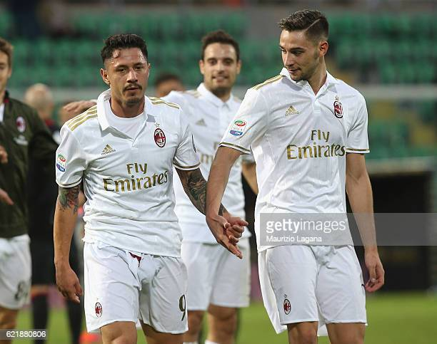 Gianluca Lapadula and Mattia De Sciglio of Milan during the Serie A match between US Citta di Palermo and AC Milan at Stadio Renzo Barbera on...