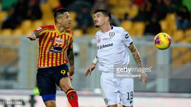 Gianluca Lapadula for the ball in air with FAbio Pisacane of Cagliari during the Serie A match between US Lecce and Cagliari Calcio at Stadio Via del...