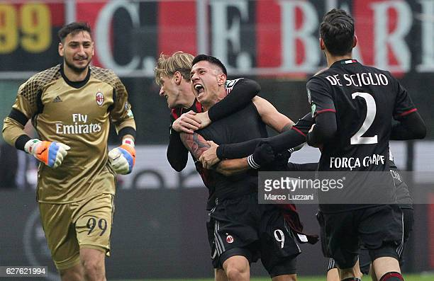 Gianluca Lapadula of AC Milan celebrates his goal with his teammates during the Serie A match between AC Milan and FC Crotone at Stadio Giuseppe...