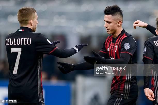 Gianluca Lapadula of AC Milan celebrates with Gerard Deulofeu after scoring a goal during the Serie A football match between AC Milan and AC...