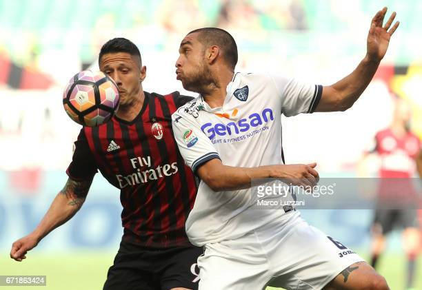 Gianluca Lapadula of AC Milan competes for the ball with Giuseppe Bellusci of Empoli FC during the Serie A match between AC Milan and Empoli FC at...