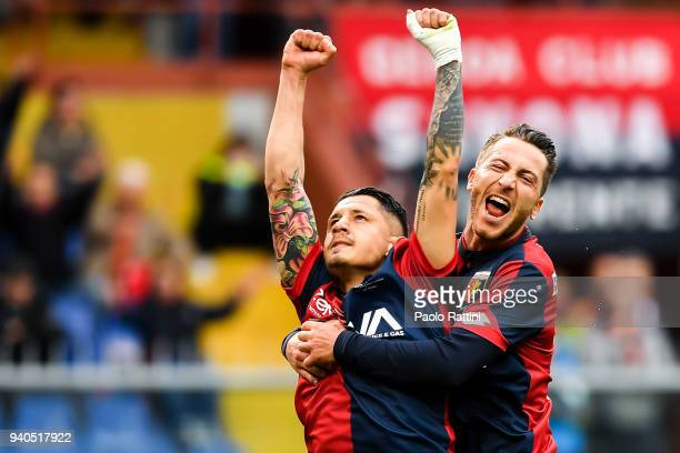 Gianluca Lapadula of Genoa celebrates with Andrea Bertolacci after scoring a goal on a penalty kick during the serie A match between Genoa CFC and...