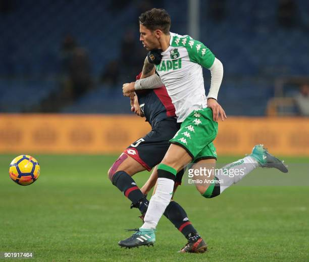 Gianluca Lapadula of Genoa CFC competes for the ball with Edoardo Goldaniga of US Sassuolo Calcio during the serie A match between Genoa CFC and US...
