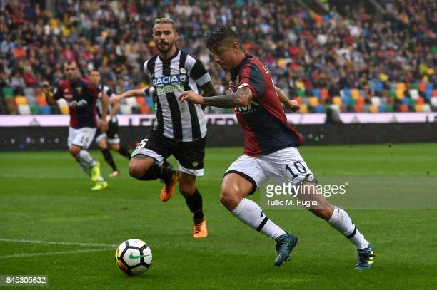 Gianluca Lapadula of Genoa is challenged by Valon Behrami of Udinese compete for the ball during the Serie A match between Udinese Calcio and Genoa...