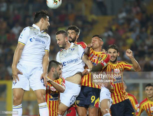 Gianluca Lapadula of Lecce competes for the ball in air with Amir Rrahamani of Hellas Verona during the Serie A match between US Lecce and Hellas...