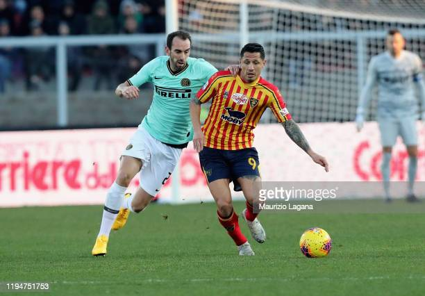 Gianluca Lapadula of Lecce competes for the ball with Diego Godin of Inter during the Serie A match between US Lecce and FC Internazionale at Stadio...