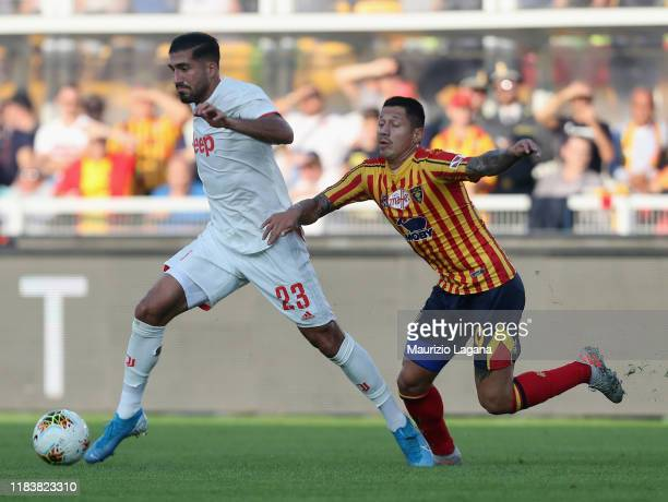 Gianluca Lapadula of Lecce competes for the ball with Emre Can of Juventus during the Serie A match between US Lecce and Juventus at Stadio Via del...