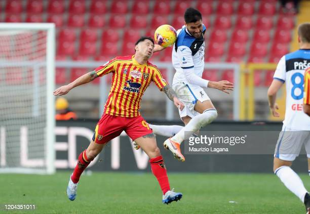 Gianluca Lapadula of Lecce competes for the ball with José Palomino of Atalanta during the Serie A match between US Lecce and Atalanta BC at Stadio...
