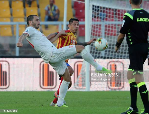 Gianluca Lapadula of Lecce competes for the ball with Leonardo Bonucci of Juventus during the Serie A match between US Lecce and Juventus at Stadio...