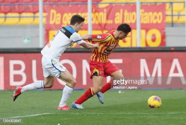 Gianluca Lapadula of Lecce competes for the ball with Matia Caldara of Atalanta during the Serie A match between US Lecce and Atalanta BC at Stadio...