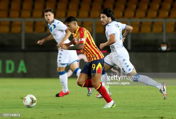 Gianluca Lapadula of Lecce competes for the ball with Sandro Tonali of Brescia during the Serie A match between US Lecce and Brescia Calcio at Stadio...