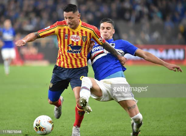 Gianluca Lapadula of US Lecce battle for the ball with Fabio Depaoli of UC Sampdoria during the Serie A match between UC Sampdoria and US Lecce at...