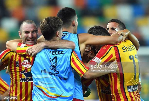 Gianluca Lapadula of US Lecce celebrates after scoring his team second goal with teammates during the Serie A match between Udinese Calcio and US...