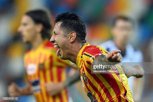 Gianluca Lapadula of US Lecce celebrates after scoring his team second goal during the Serie A match between Udinese Calcio and US Lecce at Stadio...