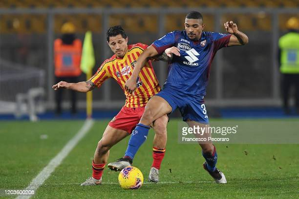 Gianluca Lapadula of US Lecce vies with Bremen of Torino FC during the Serie A match between US Lecce and Torino FC at Stadio Via del Mare on...