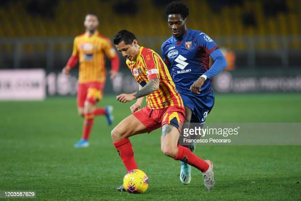 Gianluca Lapadula of US Lecce vies with Ola Aina of Torino FC during the Serie A match between US Lecce and Torino FC at Stadio Via del Mare on...