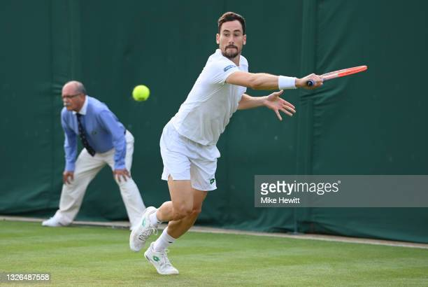 Gianluca Mager of Italy plays a backhand during his men's singles second round match against Nick Kyrgios of Australia during Day Four of The...