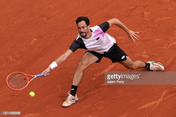 Gianluca Mager of Italy plays a forehand during his mens second round match against Jannik Sinner of Italy during day five of the 2021 French Open at...