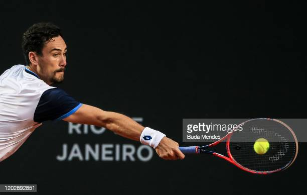 Gianluca Mager of Italy returns a shot to Cristian Garin of Chile during the men's singles final match of the ATP Rio Open 2020 at Jockey Club...