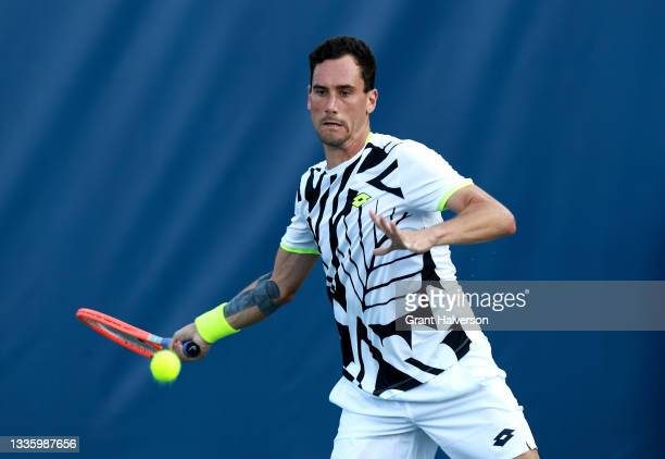 Gianluca Mager of Italy returns a shot to Tung-Lin Wu of Chinese Taipei on Day 3 of the Winston-Salem Open at Wake Forest Tennis Complex on August...