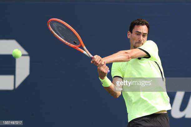 Gianluca Mager of Italy returns the ball against Jordan Thompson of Australia during his Men's Singles first round match on Day Two of the 2021 US...