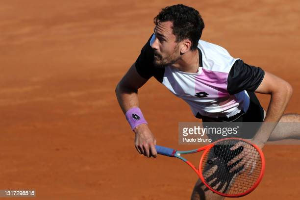 Gianluca Mager of Italy serves on day 3 of the the Internazionali BNL d'Italia tennis match between Gianluca Mager of Italy and Alex de Minaur of...
