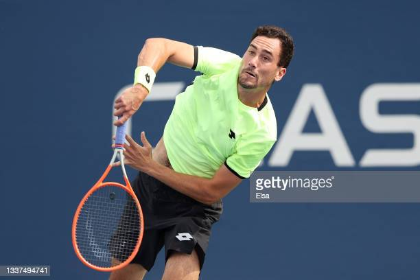 Gianluca Mager of Italy serves the ball against Jordan Thompson of Australia during his Men's Singles first round match on Day Two of the 2021 US...