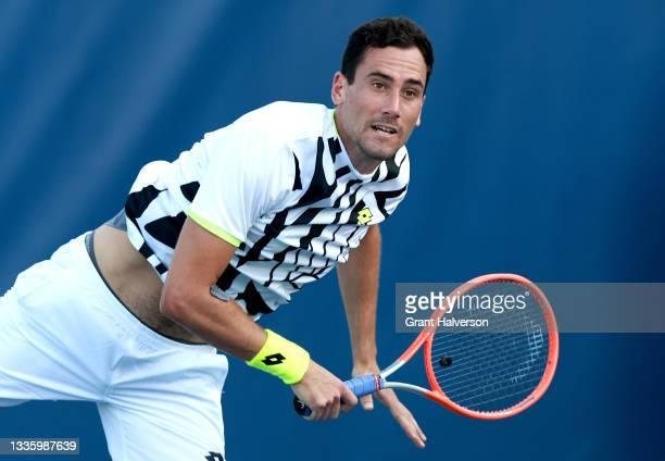 Gianluca Mager of Italy serves to Tung-Lin Wu of Chinese Taipei on Day 3 of the Winston-Salem Open at Wake Forest Tennis Complex on August 23, 2021...