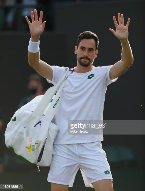 Gianluca Mager of Italy waves to the crowd during his men's singles second round match against Nick Kyrgios of Australia during Day Four of The...