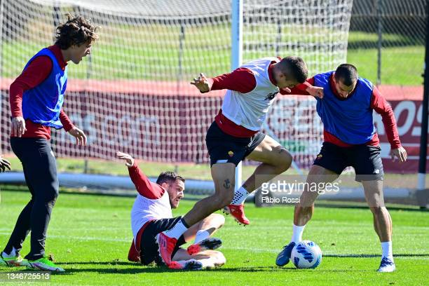 Gianluca Mancini and Henrikh Mkhitaryan fight for the ball during a training session at Centro Sportivo Fulvio Bernardini on October 15, 2021 in...