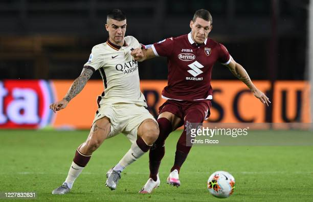 Gianluca Mancini of AS Roma challenged by Andrea Belotti of Torino FC during the Serie A match between Torino FC and AS Roma at Stadio Olimpico di...