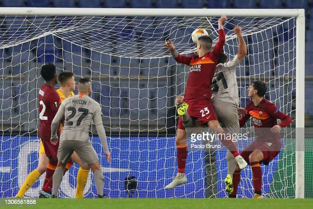 Gianluca Mancini of A.S Roma scores their side's third goal during the UEFA Europa League Round of 16 First Leg match between AS Roma and Shakhtar...
