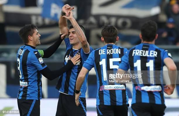 Gianluca Mancini of Atalanta BC celebrates with his teammate Rafael Toloi after scoring the opening goal during the serie A match between Atalanta BC...