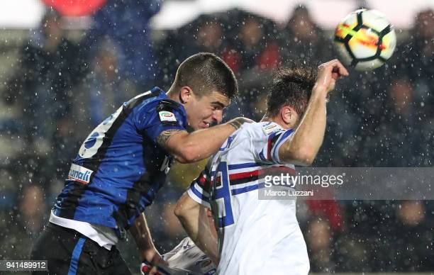 Gianluca Mancini of Atalanta BC competes for the ball with Vasco Regini of UC Sampdoria during the serie A match between Atalanta BC and UC Sampdoria...