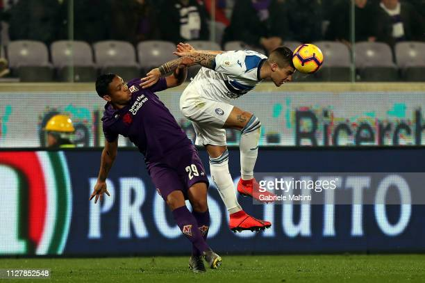 Gianluca Mancini of Atalanta BC heads the ball against Luis Muriel of ACF Fiorentina during the Coppa Italia match between ACF Fiorentina and...
