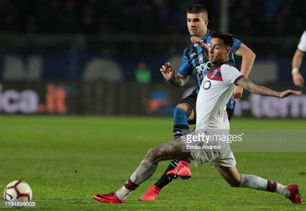 Gianluca Mancini of Atalanta BC is challenged by Erick Pulgar of Bologna FC during the Serie A match between Atalanta BC and Bologna FC at Stadio...