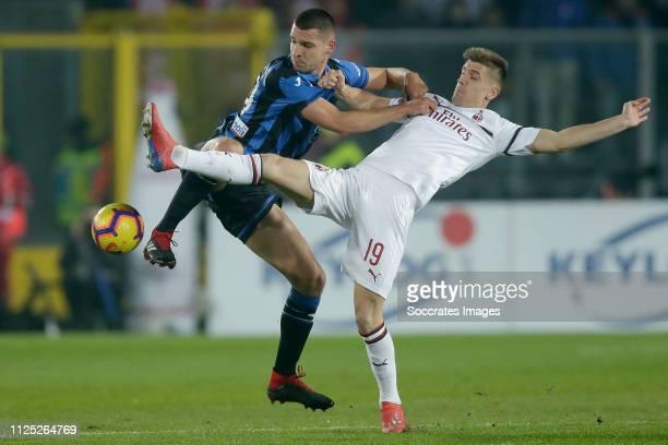 Gianluca Mancini of Atalanta Bergamo Krzysztof Piatek of AC Milan during the Italian Serie A match between Atalanta Bergamo v AC Milan at the Stadio...