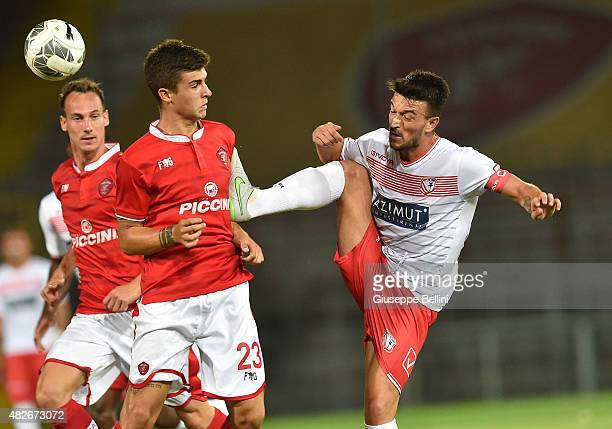 Gianluca Mancini of Perugia and Raffaele Bianco of Carpi in action during the preseason friendly match between AC Perugia and Carpi FC at Stadio...