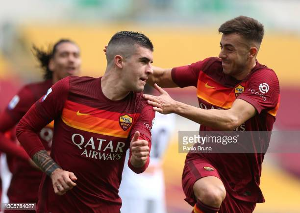 Gianluca Mancini of Roma celebrates with team mate Stephan El Shaarawy after scoring their side's first goal during the Serie A match between AS Roma...