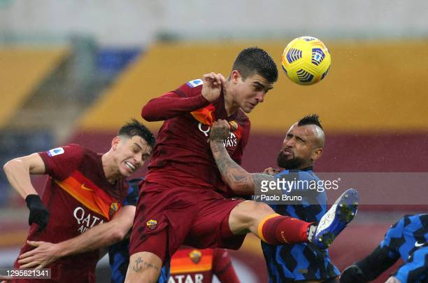 Gianluca Mancini of Roma heads the ball whilst under pressure from Arturo Vidal of Internazionale during the Serie A match between AS Roma and FC...