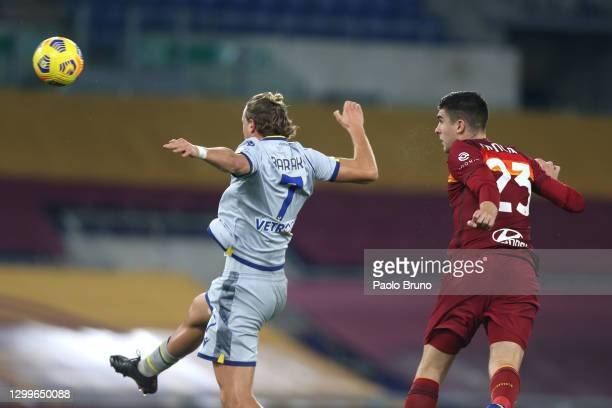 Gianluca Mancini of Roma scores their side's first goal whilst under pressure from Antonin Barak of Verona during the Serie A match between AS Roma...