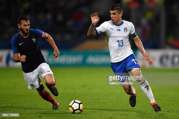 Gianluca Mancini )R) of Italy U21 in action against Lucas Tousart of France U21 during the International Friendly match between France U21 and Italy...