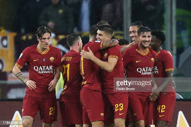 Gianluca Mancini with his teammates of AS Roma celebrates after scoring the team's second goal during the Serie A match between AS Roma and Brescia...