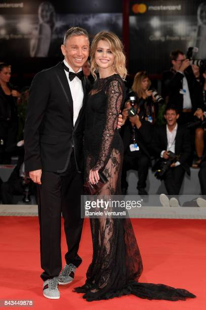 Gianluca Mech and Alexandra Dinu walk the red carpet ahead of the 'Loving Pablo' screening during the 74th Venice Film Festival at Sala Grande on...