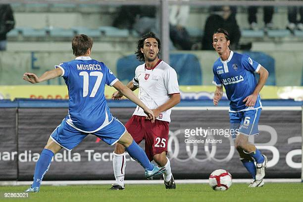 Gianluca Musacci and Mirko Valdifiori of Empoli FC in action against Piermario Morosini of Reggina Calcio during the Serie B match between Empoli FC...